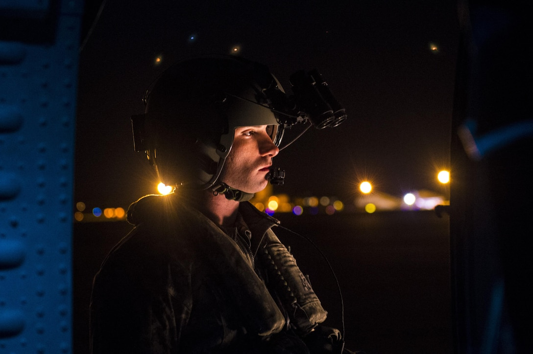 An Army crew chief performs pre-flight inspections on an UH-60L Black Hawk during Emerald Warrior 17 at Hurlburt Field, Fla., March 3, 2017. Emerald Warrior is a U.S. Special Operations Command exercise during which joint special operations forces train to respond to various threats across the spectrum of conflict. (U.S. Air Force photo/Airman 1st Class Keifer Bowes)