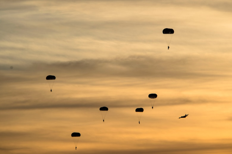 Soldiers from the 7th Special Forces Group jump from an MC-130J Commando II during Emerald Warrior 17 at Hurlburt Field, Fla., March 8, 2017. Emerald Warrior is a U.S. Special Operations Command exercise during which joint special operations forces train to respond to various threats across the spectrum of conflict. (U.S. Air Force photo/Airman 1st Class Nicholas Dutton)
