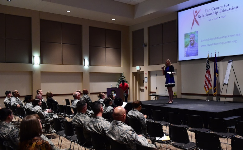 Christina Grooms, 460th Space Wing community support coordinator, speaks March 9, 2017, during the Gender Differences Symposium at the Leadership Development Center on Buckley Air Force, Colo. The symposium was the kickoff event for the new mentoring programs on base. Man-to-Man is the group for men, while UpLift is for women. (U.S. Air Force photo by Airman 1st Class Gabrielle Spradling/Released)