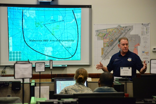 Brian Wilkinson, 341st Civil Engineer Squadron readiness and emergency management flight installation emergency manager, briefs members of the Emergency Operations Center March 9, 2017, at Malmstrom Air Force Base, Mont. Wilkinson is responsible for ensuring smooth operations inside the EOC during a time of crisis. (U.S. Air Force photo/Airman 1st Class Daniel Brosam)