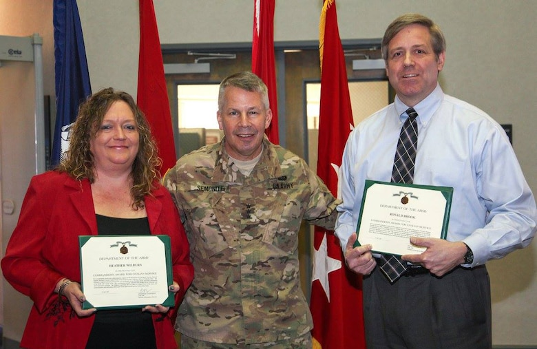 During his visit to Huntsville Center Feb. 16, U.S. Army Corps of Engineers Commander Lt. Gen. Todd Semonite presented Commander's Awards for Civilian Service to Access Control Point Program's Heather Wilburn and Ron Brook on behalf of Col. Eugenia Guilmartin, Fort Bragg's director of emergency services. The awards were for exceptionally meritorious achievement in support of access control point projects there.