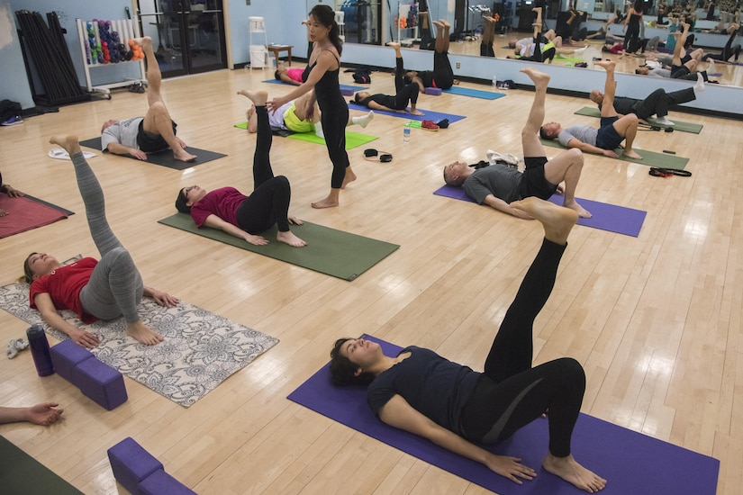Le Nguyen, West Fitness Center yoga instructor, teaches a yoga lesson at Joint Base Andrews, Md., March 9, 2017. Nguyen holds an hour-long yoga class every Thursday at 5 p.m. for yogis of all experience levels. The class focuses on the study of Iyengar Yoga, which emphasizes detailed posture performance and breath control. (U.S. Air Force photo by Airman 1st Class Valentina Lopez)