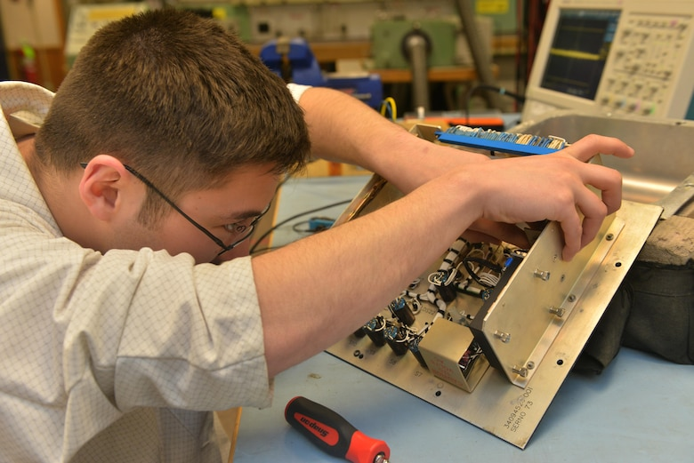 Senior Airman Maxwell Clement, 791st Maintenance Squadron electronic laboratory technician, removes a controller monitor filter at Minot Air Force Base, N.D., March 2, 2017. Electronic laboratory technicians inspect, troubleshoot, and repair electronic components and test equipment for launch facilities and launch control centers. (U.S. Air Force photo/Airman 1st Class Jessica Weissman)