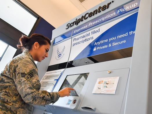 Senior Airman Samantha Laredo uses the prescription kiosk outside the Staff Sgt. Derek F. Ramos Satellite Pharmacy inside the Hill Air Force Base Exchange, March 10. The ScriptCenter kiosk provides TRICARE beneficiaries expanded pharmacy access to pick up refills during weekends, holidays (excluding Thanksgiving and Christmas), and weekdays after hours until 7 p.m., or anytime the Exchange is open. (U.S. Air Force/R. Nial Bradshaw)
