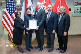 The U.S. Army Corps of Engineers was presented the Government-Wide Category Management Best in Class Solution award in a ceremony at the USACE headquarters in Washington, D.C., on Feb. 27.  From left to right: Jacqueline Woodson, USACE acting deputy director of Contracting; Mary Ruwwe, GSA Facilities and Construction Category; Lloyd Caldwell, USACE director of Military Programs; Charles Ford, Huntsville Engineering and Support Center programs director; and Stacey Hirata, USACE chief of Installation Support.