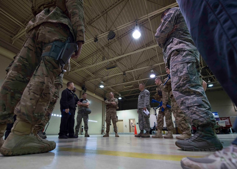 Air Commandos are briefed on new procedures for active shooter responses during multi-squadron training at Hurlburt Field, Fla., March 10, 2017. Air Commandos with the 1st Special Operations Security Forces Squadron, 1st Special Operations Civil Engineer Squadron and the 1st Special Operations Medical Group participated in an exercise to implement new procedures for tactical responders. (U.S. Air Force photo by Senior Airman Krystal M. Garrett)