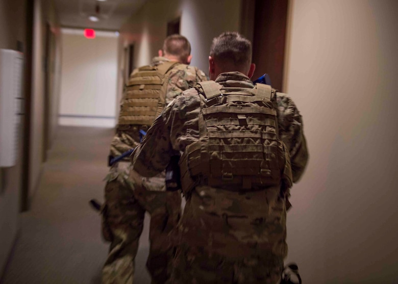 Air Commandos with the 1st Special Operations Security Forces Squadron clear a building during an active shooter exercise at Hurlburt Field, Fla., March 10, 2017. Security Forces members are first to enter the building when notified of an active shooter. The goal is to clear the building and neutralize the threat prior to rescuing victims. (U.S. Air Force photo by Senior Airman Krystal M. Garrett)
