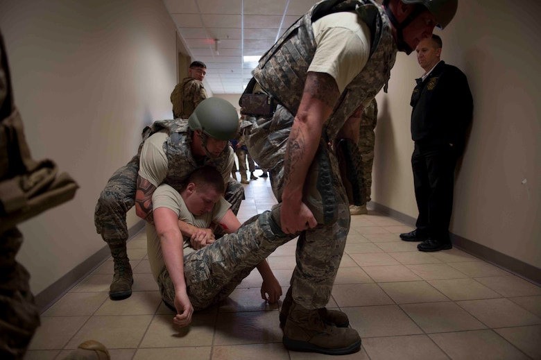 Air Commandos with the 1st Special Operations Civil Engineer Squadron perform first responder duties during an active shooter exercise at Hurlburt Field, Fla., March 10, 2017. Air Commandos with the 1st Special Operations Security Forces Squadron, 1st Special Operations Civil Engineer Squadron and the 1st Special Operations Medical Group participated in the exercise to practice new procedures for tactical responders. (U.S. Air Force photo by Senior Airman Krystal M. Garrett)