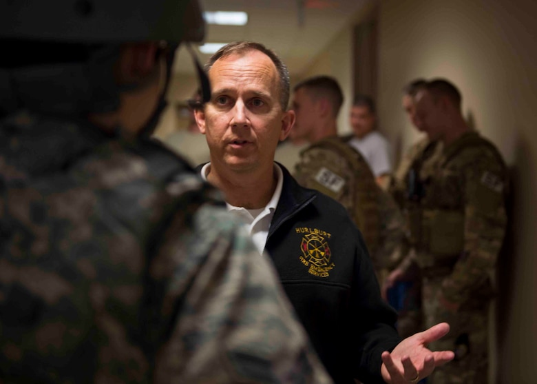 Christopher Maxwell, assistant fire chief of training for the 1st Special Operations Civil Engineer Squadron, explains procedures to an Air Commando during an active shooter exercise at Hurlburt Field, Fla., March 10, 2017. The exercise was held to implement new procedures for tactical responders and aide in increasing survival chances of wounded victims. (U.S. Air Force photo by Senior Airman Krystal M. Garrett)