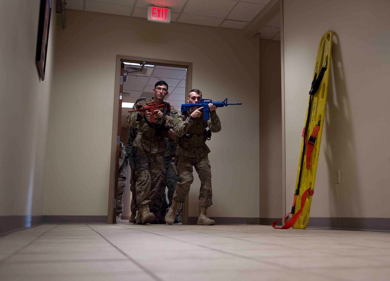 Air Commandos with the 1st Special Operations Security Forces and the 1st Special Operations Civil Engineer Squadron perform first responder duties during an active shooter exercise at Hurlburt Field, Fla., March 10, 2017. Air Commandos with the 1st Special Operations Security Forces Squadron, 1st SOCES and the 1st Special Operations Medical Group participated in an exercise to implement new procedures for tactical responders. (U.S. Air Force photo by Senior Airman Krystal M. Garrett)