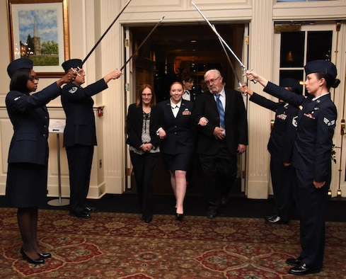 NEWARK, DE- Staff Sgt. Gabrielle Rieker, family readiness program manager, 166th Airlift Wing, enters the Deerfield Golf and Tennis Club ballroom with her parents Laura and Bill Rieker, during the Delaware Air National Guard Annual Enlisted Recognition Banquet held on March 4, 2017. Rieker received the 2016 Airman of the Year Award, which is awarded to an airman between the rank of E1-E4 for stellar performance and going above and beyond. (U.S. Air National Guard photo by Tech. Sgt. Gwendolyn Blakley/ Released).