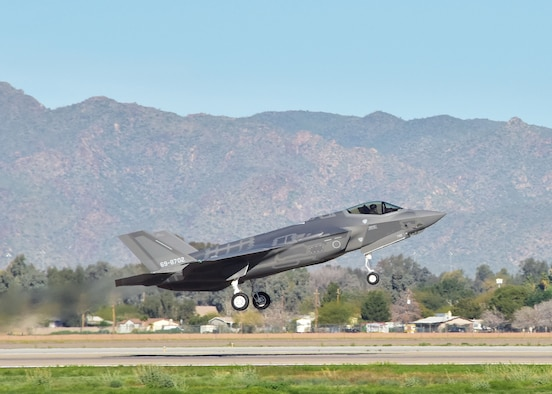 "Maj. Michael ""Frog"" Hobson, 944th Operations Group Detachment 2, takes-off on an F-35A Mar. 7 during the 100th sortie milestone at Luke Air Force Base, Ariz. (U.S. Air Force photo by Tech. Sgt. Louis Vega Jr.)"