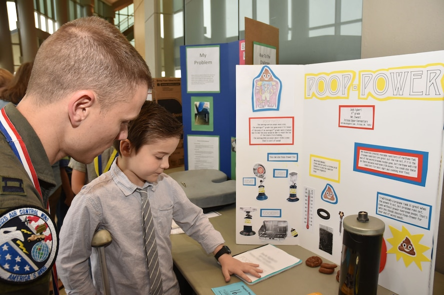 Capt. Jeremy, 963rd Airborne Air Control Squadron, listens as a student inventor explains his idea for alternative energy during the 28th annual Oklahoma Student Inventors Exposition held at Rose State College, Feb. 28. More than 20 members of the 552nd Air Control Wing volunteered to serve as judges. The expo featured 180 students in grades 2 to 12 from 22 schools across the state.  (Air Force photo by Ron Mullan)