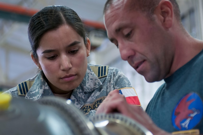 Tech. Sgt. Michael Dominguez an engine mechanic with the 162nd Wing  and Chilean air force exchange officer Capt. Andrea Garcia work together to troubleshoot a maintenance issue.  Garcia spent two years with the Arizona Air National Guard's 162nd Wing learning F-16 maintenance processes and sharing experiences. (U.S. Air National Guard photo by Staff Sgt. Gregory Ferreira)
