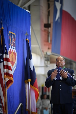 Command Chief Master Sgt. George Longoria holds an American flag during his retirement ceremony at Joint Base San Antonio-Lackland, Texas, Feb. 25, 2017. Longoria retires after 35 years of service with the 149th Fighter Wing, Texas Air National Guard. (U.S. Air National Guard photo by Tech. Sgt. Eric L. Wilson)
