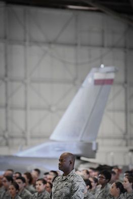 Lt. Col. Antwan Hopkins, wing chief of staff and comptroller flight commander, serves as the flight commander for a formation of the 149th Fighter Wing, Texas Air National Guard during a retirement ceremony honoring Command Chief Master Sgt. George Longoria at Joint Base San Antonio-Lackland, Texas, Feb. 25, 2017. Longoria retires after 35 years of military service. (U.S. Air National Guard photo by Tech. Sgt. Eric L. Wilson)