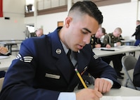 U.S. Air Force Senior Airman Orlando Duarte, an aerospace propulsion mechanic with the 149th Fighter Wing, Texas Air National Guard, headquartered at Joint Base San Antonio-Lackland, Texas, writes an essay for the Texas Military Department's Best Warrior Competition, March 2, 2017 at Camp Swift, Bastrop, Texas. Duarte was graded on his essay question as well as an appearance board on the first day of the competition. (U.S. Army National Guard photo by Sgt. Marline Duncan)