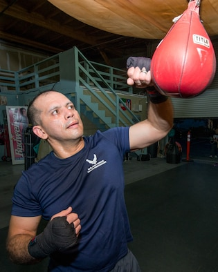 U.S. Air Force Capt. Eduardo Torrez, 60th Medical Operations Squadron, Travis Air Force Base, Calif., performs boxing drills at the JL Tepito Boxing Club in Fairfield, Calif., Feb. 27, 2017. Torrez is a nurse at David Grant USAF Medical Center and was an amateur boxer before joining the Air Force. (U.S. Air Force photo/Louis Briscese)