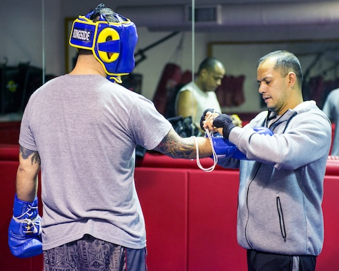 U.S. Air Force Capt. Eduardo Torrez, 60th Medical Operations Squadron, conducts a training session at the fitness center, Travis Air Force Base, Calif., Mar. 5, 2017. Torrez is a nurse at David Grant USAF Medical Center and was an amateur boxer before joining the Air Force. (U.S. Air Force photo/Louis Briscese)