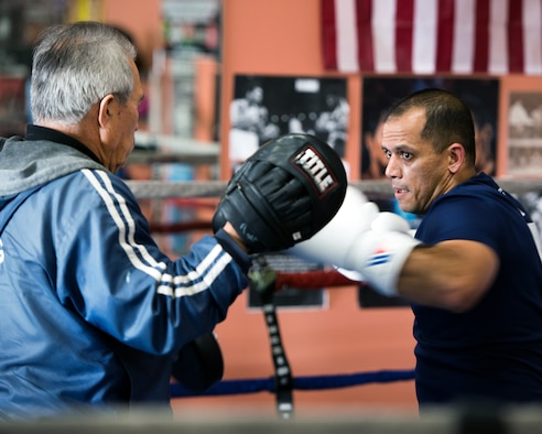 U.S. Air Force Capt. Eduardo Torrez, 60th Medical Operations Squadron, Travis Air Force Base, Calif., performs boxing drills with Jesse Lopez at the JL Tepito Boxing Club in Fairfield, Calif., Mar. 6, 2017. Torrez is a nurse at David Grant USAF Medical Center and was an amateur boxer before joining the Air Force. (U.S. Air Force photo/Louis Briscese)