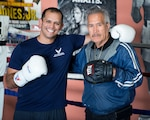 Air Force Capt. Eduardo Torrez, 60th Medical Operations Squadron, Travis Air Force Base, Calif., poses for a photo with Jesse Lopez at the JL Tepito Boxing Club in Fairfield, Calif., March 6, 2017. Torrez is a nurse at David Grant USAF Medical Center and was an amateur boxer before joining the Air Force. Air Force photo by Louis Briscese