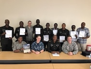 Rwandan Defence Force students, joined by members of the Defense Institute of Medical Operations, hold up International Trauma Life Support certificates earned during the first ITLS course in Rwanda. With support from the 59th Medical Wing, DIMO certified the first ever ITLS course in Rwanda earlier this year. ITLS supports medical competencies as outlined in the United Nations Medical Support Manual for Peacekeepers.
