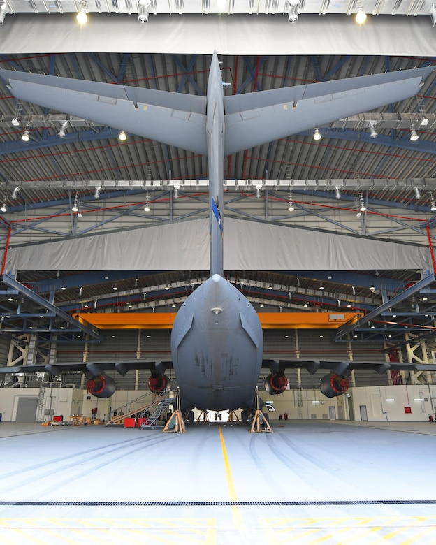 A U.S. Air Force C-17 Globemaster III is lifted inside a Qatari hangar at Al Udeid Air Base, Qatar, Feb. 25, 2017. Weather conditions such as high winds required maintenance personnel to stop working on the C-17 for safety reasons, but by parking the aircraft in the Qatari hangar, the maintainers were able to work on it uninterrupted. (U.S. Air Force photo by Senior Airman Miles Wilson)