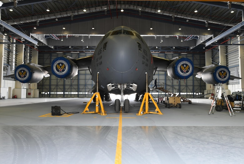 A U.S. Air Force C-17 Globemaster III is raised up inside a Qatari hangar at Al Udeid Air Base, Qatar, Feb. 25, 2017. Weather conditions such as high winds required maintenance personnel to stop working for safety reasons, but by parking the aircraft in the Qatari hangar, the maintainers were able to work on it uninterrupted. (U.S. Air Force photo by Senior Airman Miles Wilson)