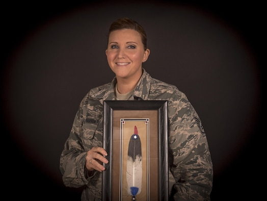 U.S. Air Force Staff Sgt. Thereasa Barker-Figueroa from the New Jersey Air National Guard's 108th Wing holds her 2016 Military Meritorious Service Award she was presented by the Society of American Indian Government Employees, Joint Base McGuire-Dix-Lakehurst, N.J., Oct. 4, 2016. Barker-Figueroa traces her lineage to the Lenni-Lenape, a group of Native American people from the Algonquin nation who populated New Jersey as well as parts of Pennsylvania and New York. (U.S. Air National Guard photo by Tech. Sgt. Matt Hecht/Released)