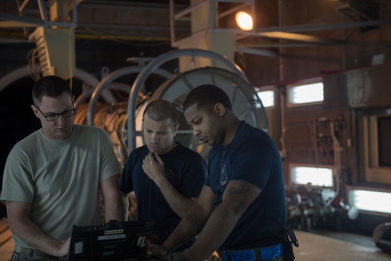 U.S. Air Force Airmen assigned to the 18th Component Maintenance Squadron research inspection limits March 10, 2017, at Kadena Air Base, Japan. Ensuring every part of the engine is ready and safe is of the highest priority when it comes to keeping the mission moving. (U.S. Air Force photo by Airman 1st Class Quay Drawdy)