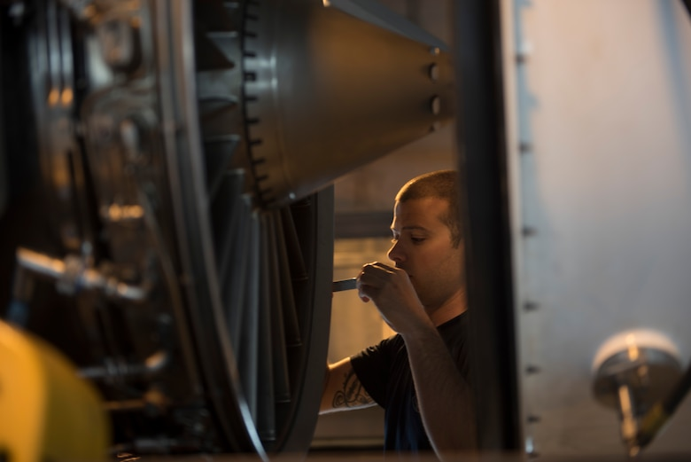 U.S. Air Force Staff Sgt. Stephen Baudo, 18th Component Maintenance Squadron aerospace propulsion craftsman, checks spacing on an engine blade March 10, 2017, at Kadena Air Base, Japan. When installing new cores into an existing unit, the entire engine goes through a rigorous series of checks and tests before being declared mission ready. (U.S. Air Force photo by Airman 1st Class Quay Drawdy)