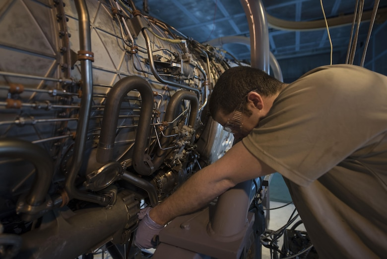 "U.S. Air Force Staff Sgt. Donovan Walters, 18th Component Maintenance Squadron aerospace propulsion craftsman, checks a valve on a F100/220 engine March 10, 2017, at Kadena Air Base, Japan. Whenever a new core is installed, the entire unit goes through a ""break-in"" process. (U.S. Air Force photo by Airman 1st Class Quay Drawdy)"