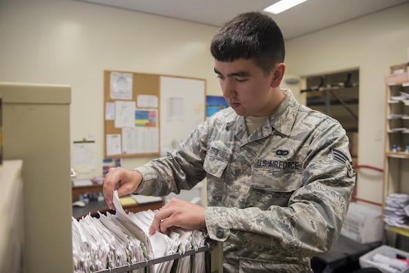 U.S. Air Force Senior Airman Calvin Cook, 18th Communications Squadron postal clerk, files member's P.O. Box information at the Kadena Air Base Post Office March 13, 2017, on Kadena Air Base, Japan. The mission of the Post Office is to provide both personal and official mail to the service members and their families here on the island. (U.S. Air Force photo by Airman 1st Class Corey Pettis/Released)