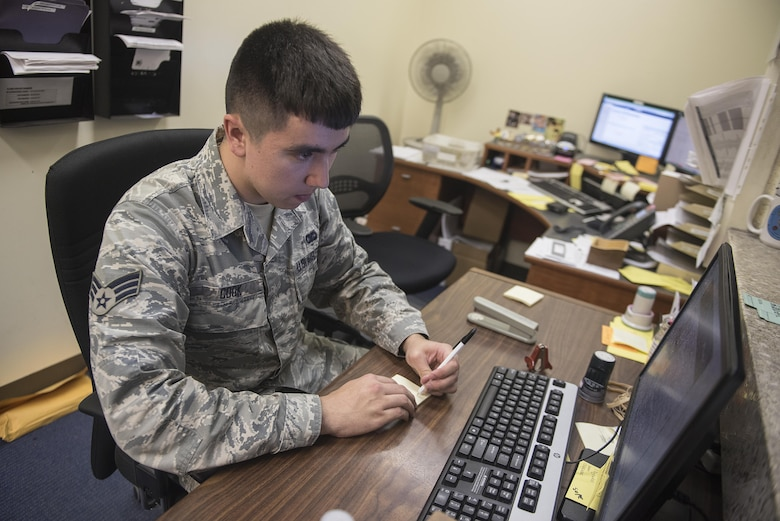 U.S. Air Force Senior Airman Calvin Cook, 18th Communications Squadron postal clerk, gathers member's P.O. Box information at the Kadena Air Base Post Office March 13, 2017, on Kadena Air Base, Japan. The duties of the base Post Office include setting up P.O. Boxes, sorting mail, loading and unloading trucks with packages and giving parcels to customers. (U.S. Air Force photo by Airman 1st Class Corey Pettis/Released)