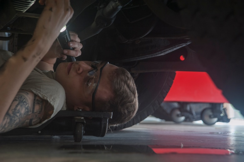 U.S. Air Force Airman 1st Class Andrew Grady, 18th Logistics Readiness Squadron special purpose vehicle maintainer, checks for fluid leaks on a government vehicle March 13, 2017, at Kadena Air Base, Japan. Attention to detail is critical when working with government vehicles. The 18th LRS ensures countless vehicles, with just as many intricate systems, are well kept and ready to perform. (U.S. Air Force photo by Airman 1st Class Quay Drawdy)