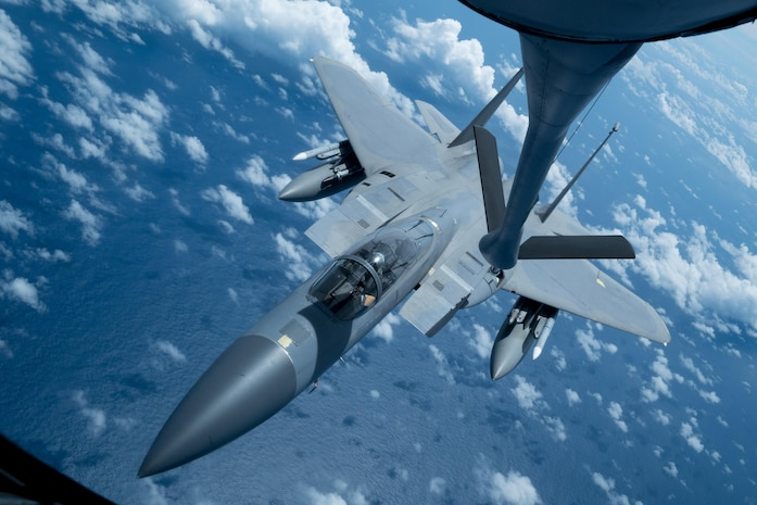 A U.S. Air Force F-15 Eagle from the 67th Fighter Squadron receives an inflight refuel from a KC-135 Stratotanker from the 909th Air Refueling Squadron March 6, 2017, en route to Kadena Air Base, Japan. Both Squadrons returned to Kadena after spending three weeks training with Australian and Japanese partners for exercise Cope North at Andersen Air Force Base, Guam. During the exercise, the 909th ARS flew 23 sorties and offloaded more than 1.1 million pounds of fuel to 180 receivers. (U.S. Air Force photo by Senior Airman John Linzmeier)