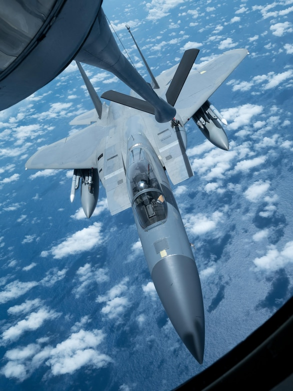 A U.S. Air Force F-15 Eagle from the 67th Fighter Squadron receives an inflight refuel from a KC-135 Stratotanker from the 909th Air Refueling Squadron March 6, 2017, in route to Kadena Air Base, Japan. Both Squadrons returned to Kadena after spending three weeks training with Australian and Japanese partners for exercise Cope North at Andersen Air Force Base, Guam. The 909th ARS's motto is 'Always There,' symbolizing the squadron's constant presence and devotion to support allies and partners throughout the Indo-Asia Pacific. (U.S. Air Force photo by Senior Airman John Linzmeier)