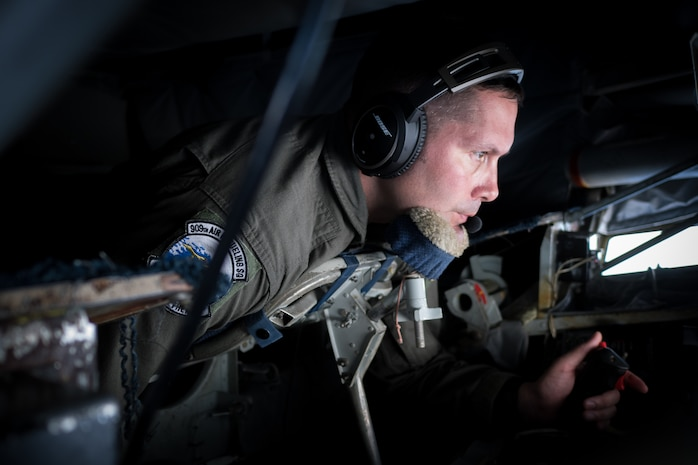 U.S. Air Force Senior Master Sgt. Douglas Palmisano, 909th Air Refueling Squadron boom operator and superintendent, conducts an inflight refuel March 6, 2017, en route to Kadena Air Base, Japan. Boom operators on a KC-135 have the ability to pump thousands of pounds of fuel to any capable aircraft, thousands of feet above the ground, flying at 230 miles per hour, while only 47 feet from the receiving aircraft. (U.S. Air Force photo by Senior Airman John Linzmeier)