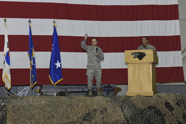 Maj. Gen. James Slife, Deputy Chief of Staff for the UN Command and U.S. Forces Korea, holds up a glass of water for a toast during the Maintenance Professional of the Year banquet March 10, 2017 at Kunsan Air Base, Republic of Korea. Slife, who presided over the event, and members from the 8th Fighter Wing gathered in Hangar 3 here to recognize airmen from multiple maintenance career fields for their outstanding achievements in 2016. (U.S. Air Force photo by Senior Airman Michael Hunsaker/Released)