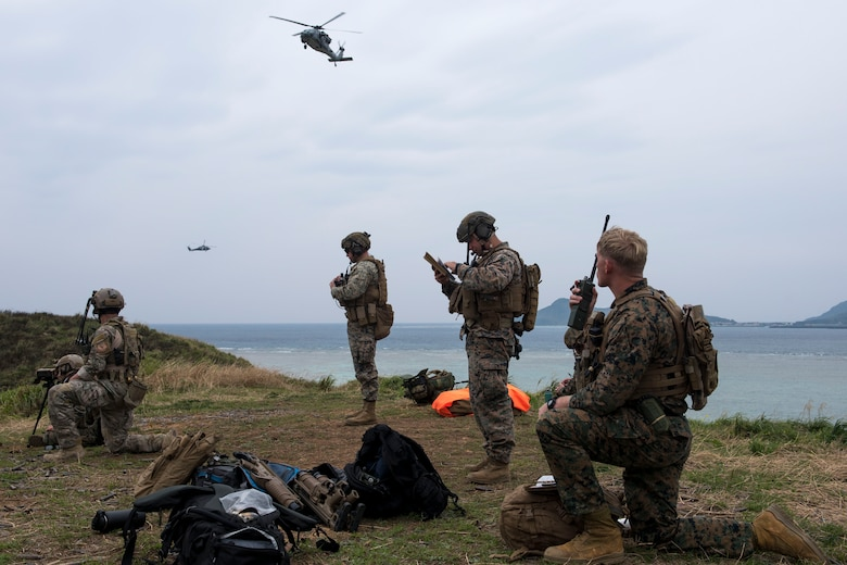 A U.S. Air Force combat control Airman from the 320th Special Tactics Squadron, and U.S. Marine Corps marine joint terminal attack controllers from the 5th Air Naval Gunfire Liaison Company, III Marine Expeditionary Force, call in close air support March 10, 2017, at the Irisuna Jima Training Range, Okinawa, Japan. Members of the 320th STS and III MEF frequently training together to in order to maintain an understanding of each other's practices and  capabilities. Combat control Airmen and JTAC Marines are experts at calling in air support in hostile, complex environments. (U.S. Air Force photo by Senior Airman John Linzmeier)
