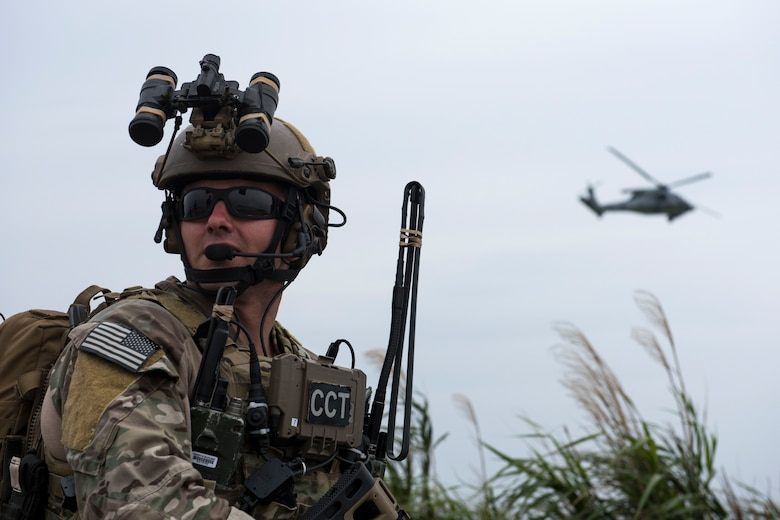 A U.S. Air Force combat control Airman from the 320th Special Tactics Squadron communicates with a U.S. Navy HH-60 Sea Hawk from the Helicopter Sea Combat Unit 12 during a training exercise March 10, 2017, at the Irisuna Jima Training Range, Okinawa, Japan. Combat controllers execute complex air-to-ground missions that integrate ground-based radio operations with fixed and rotary wing aircraft in combat environments. (U.S. Air Force photo by Senior Airman John Linzmeier)