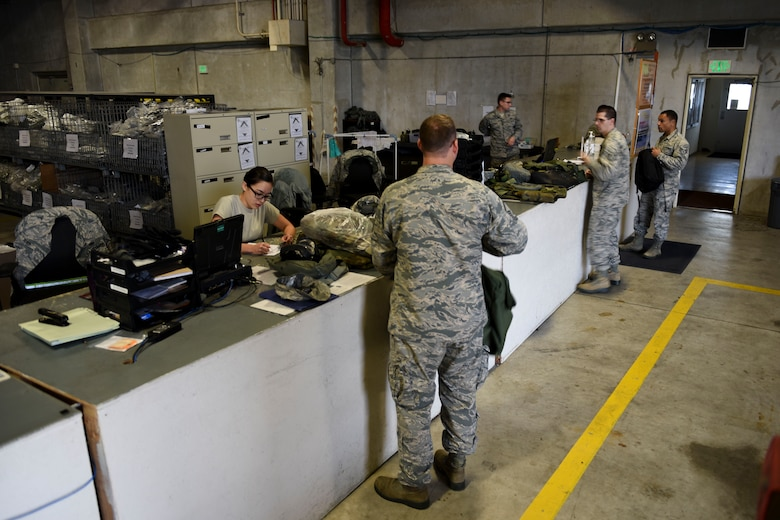 Members of Team Kadena visit the 18th Logistics Readiness Squadron Individual Protective Equipment Shop to turn in equipment March 13, 2017, at Kadena Air Base, Japan. The IPE Shop issues equipment such as gas masks, sleeping bags and tactical vests to Airmen for training purposes and deployments. (U.S. Air Force photo by Senior Airman John Linzmeier)