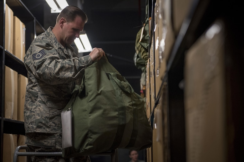 U.S. Air Force Staff Sgt. Christopher Clark, 445th Logistics Readiness Squadron material management technician, inspects individual protective equipment March 13, 2017, at Kadena Air Base, Japan. Clark and other reservist Airmen from Wright-Patterson Air Force Base, Ohio, are temporarily working in the 18th LRS's IPE Shop as part of their annual overseas assignment. (U.S. Air Force photo by Senior Airman John Linzmeier)