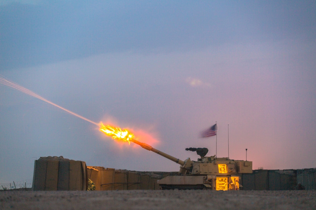 A U.S. Army M109A6 Paladin deployed in support of Combined Joint Task Force – Operation Inherent Resolve, assigned to Bravo Battery, 2-82nd Field Artillery, 3rd Brigade, 1st Calvary Division fires during training operation at Camp Manion Iraq, March 10, 2017. Bravo Battery provides base security in support of Combined Joint Task Force – Operation Inherent Resolve, the global Coalition to defeat ISIS in Iraq and Syria.  (U.S. Army photo by Spc. Christopher Brecht)