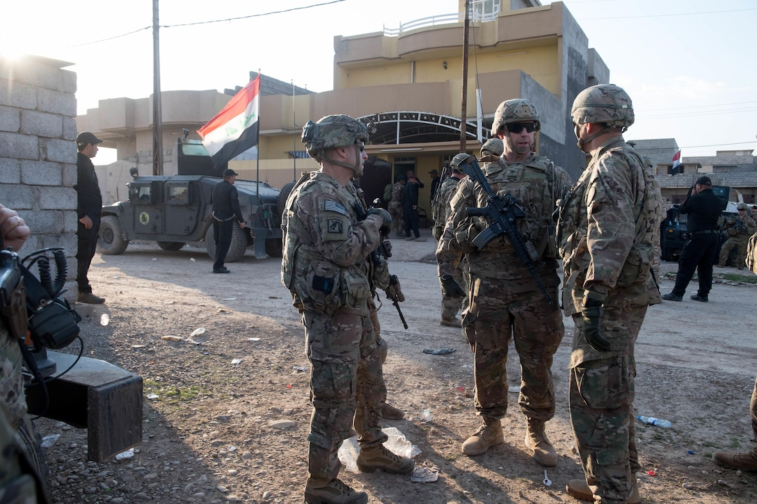 U.S. Army Lt. Gen. Stephen J. Townsend, right, commanding general, Combined Joint Task Force - Operation Inherent Resolve, talks with Col. James P. Work, commander 2nd Brigade Combat Team, 82nd Airborne Division, and Command Sergeant Major Benjamin J. Jones, senior enlisted advisor for CJTF-OIR, during a battlefield circulation near Mosul, Iraq, March 08, 2017. A global Coalition of more than 60 regional and international nations have joined together to enable partner forces to defeat ISIS. CJTF-OIR is the global Coalition to defeat ISIS in Iraq and Syria. (U.S. Army photo by Staff Sgt. Alex Manne)