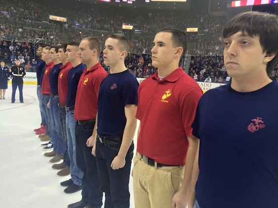 U.S. Marine Corps Poolees with Marine Corps Recruiting Sub-Stations North and South Columbus stand on the ice during an Oath of Enlistment ceremony at the Columbus Blue Jackets game Jan. 21, 2017. The Oath of Enlistment pledge is made by each enlisted member of the Armed Forces. This is the final step before basic training and confirms their duty to defend the constitution and obey orders given by officers appointed over them.  (U.S. Marine Corps photo by Sgt. Caitlin Brink/Released)