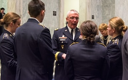 (Center) Deputy Chief of the Army Reserve Maj. Gen. Michael R. Smith speaks with Georgetown University Reserve Officers' Training Corps cadets at the U.S. Army Women's Foundation Hall of Fame Induction ceremony in Washington, D.C., on March 8, 2017.