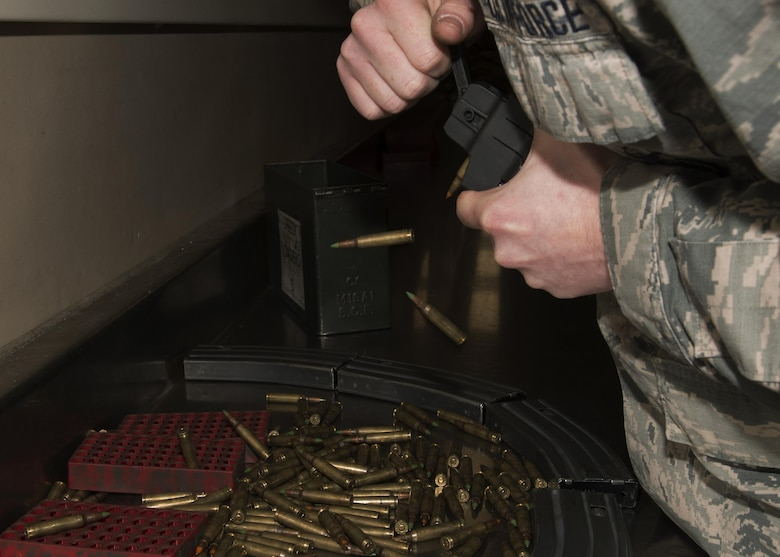 Airman 1st Class Cody Daganhart, 5th Security Forces Squadron staff armorer, unloads M4 carbine magazines at the armory on Minot Air Force Base, N.D., March 1, 2017. All ammo is inspected before it's placed back in the armory. (U.S. Air Force photo/Airman 1st Class Alyssa M. Akers)