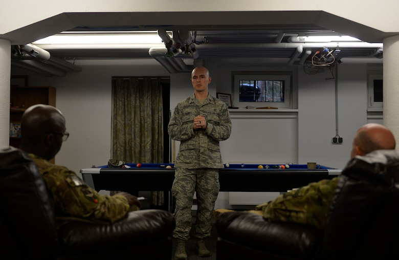 Maj. Corey Carnes, Deployment Transition Center director, conducts a welcome brief for redeploying Airmen on Ramstein Air Base, Germany, Feb. 2, 2017. The DTC takes redeployers through a four-day re-immersion course which aims to help them ease back into non-deployed life. (U.S. Air Force photo by Airman 1st Class Joshua Magbanua)