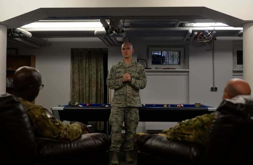 Maj. Corey Carnes, the Deployment Transition Center director, conducts a welcome brief for redeploying Airmen on Ramstein Air Base, Germany, Feb. 2, 2017. The DTC takes redeployers through a four-day re-immersion course which aims to help them ease back into non-deployed life. (U.S. Air Force photo/Airman 1st Class Joshua Magbanua)